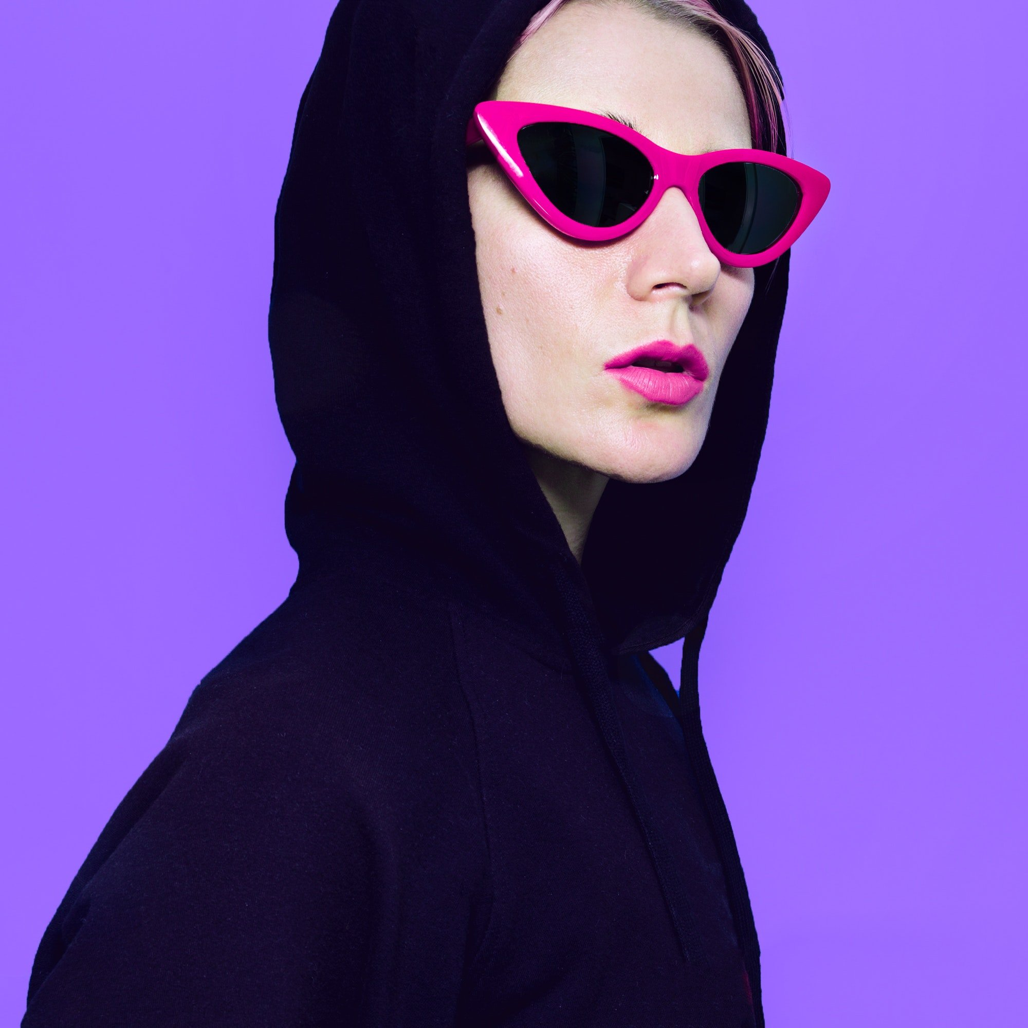 blonde-girl-in-fashion-sunglasses-and-hoody-urban-street-outfit.jpg