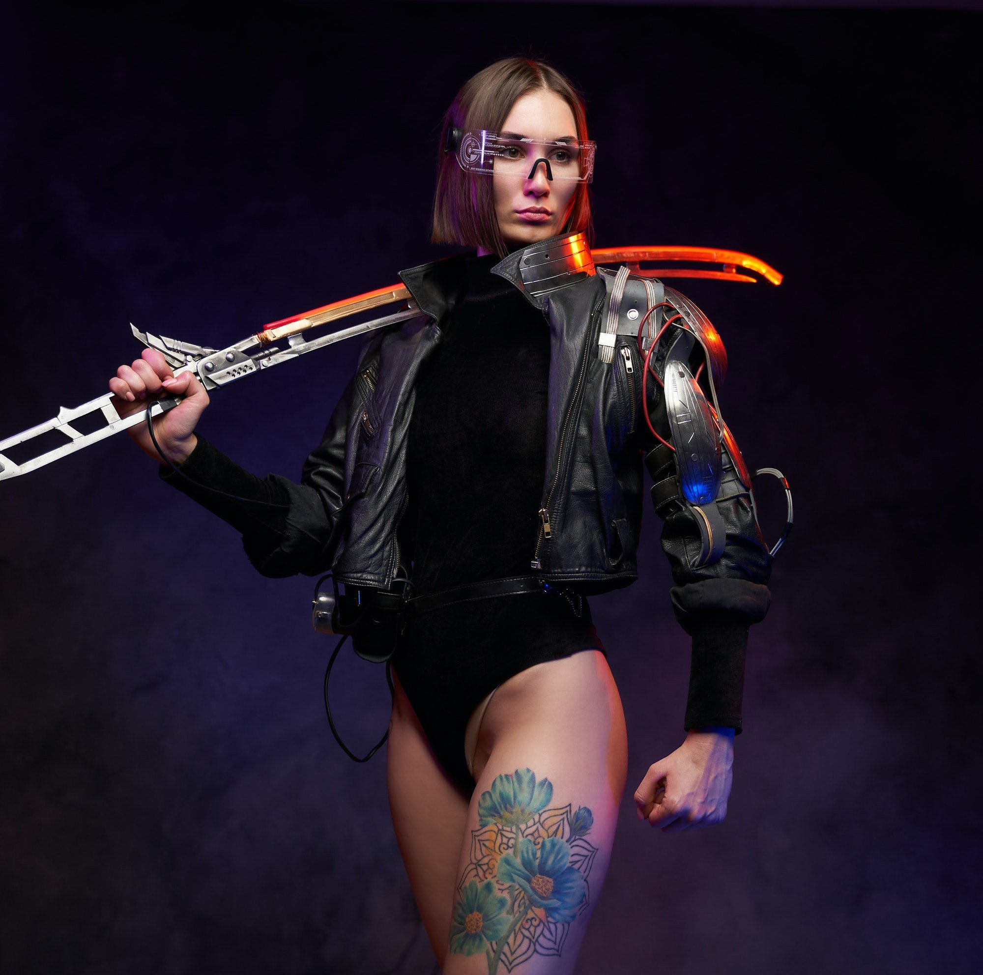 urban-and-cyberpunk-styled-woman-assassin-with-sword-posing-in-studio.jpg